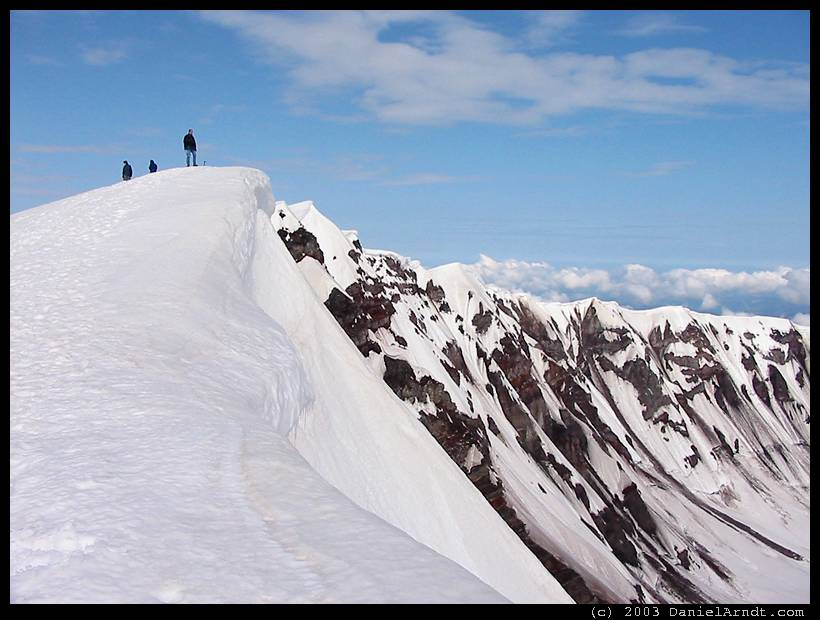 Climb of Mount St. Helens: on the crater rim, watching that cornice