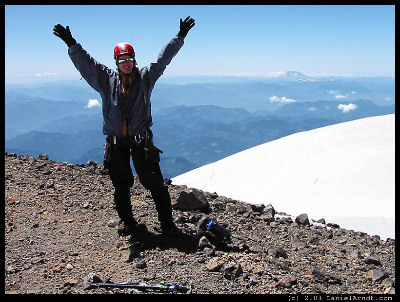 Climb of Mount Rainier: Daniel on the summit with Mount St Helens in the background