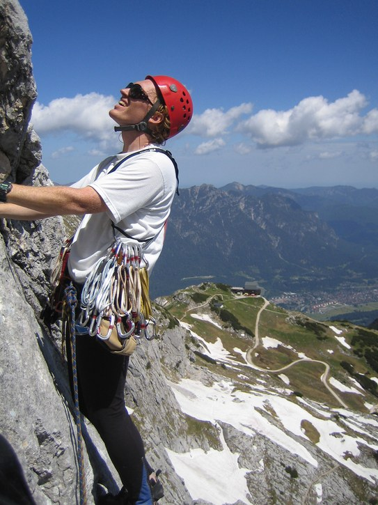 Alpspitze via KG-Weg: Michael leading a pitch on the KG-Weg; Alpspitzbahn gondola in the background