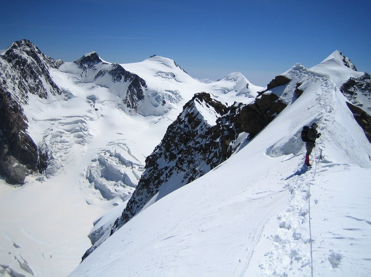 Lyskamm ridge traverse and Castor: Claus-Dieter on the ridge traverse from Lyskamm East to Lyskamm West summit; in the background from left to right: Dufourspitze (with Grenzgletscher), Zumsteinspitze, Signalkuppe, and Parrotspitze