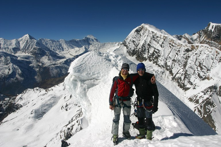 Chulu Far East Climb: Daniel and Andreas on the summit; in the background Gangapurna (7455 m) and Annapurna I (8091 m) (on the right)