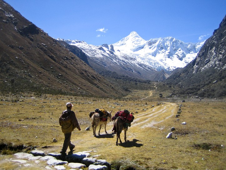 Travel to Ishinca Base Camp: approaching Ishinca Base Camp with Tocllaraju in the background