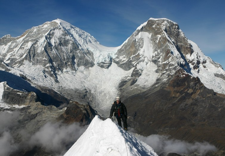 Yanapaccha climb: Jim on the summit of Yanapaccha (5347 m) with Huascaran Sur (6768 m) and Norte (6664 m) looming behind