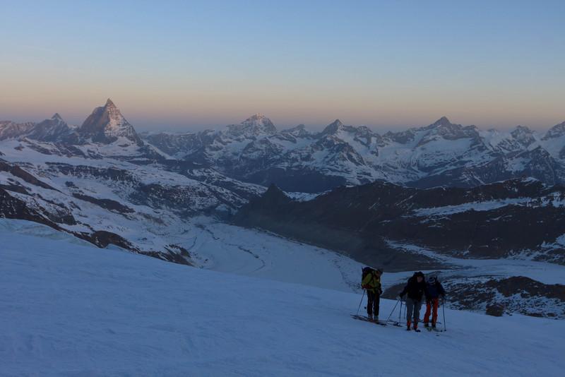 Skiers ascending Dufourspitze with Matterhorn, Dent Blanche etc behind (keywords: alpen, alps, berg, berge, dent blanche, dent d'hérens, leute, matterhorn, obergabelhorn, person, schweiz, sonnenaufgang, switzerland, valais, wallis, wellenkuppe, zinalrothorn, mountain, mountains, people, skier, sunrise, swiss, dent d'hrens)