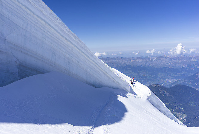 Climbers near a serac wall on the glacier (keywords: serac, seracs, climbers, Mont Blanc massif, glacier)